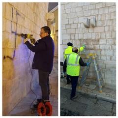 rimossa la svastica dal muro del campanile della chiesa Cattedrale